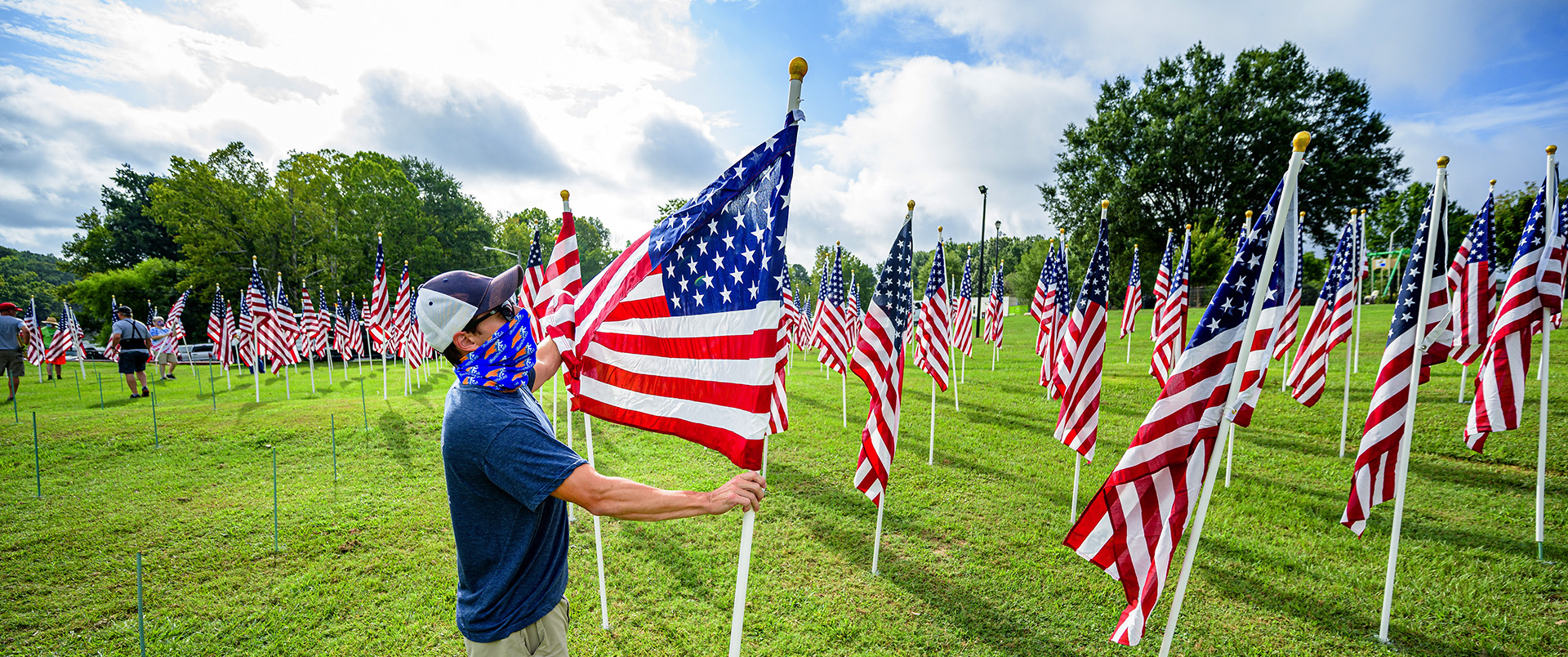 Man installing flag at Field of Honor