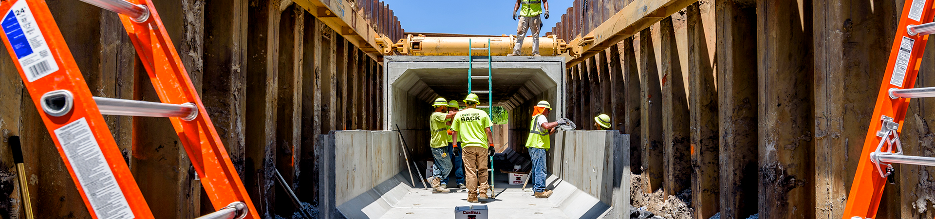 workers inside the town creek culvert