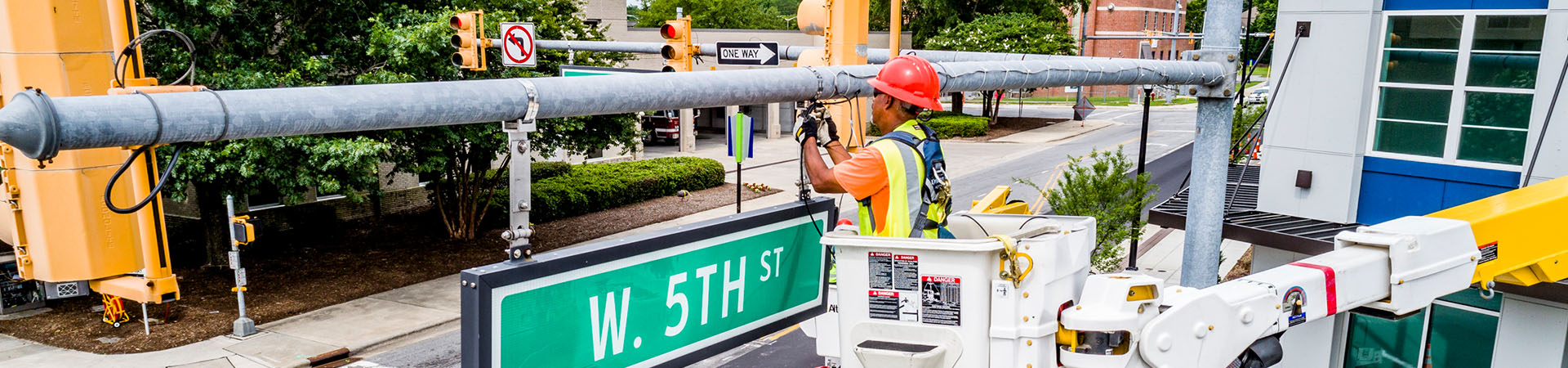 worker repairing a traffic light