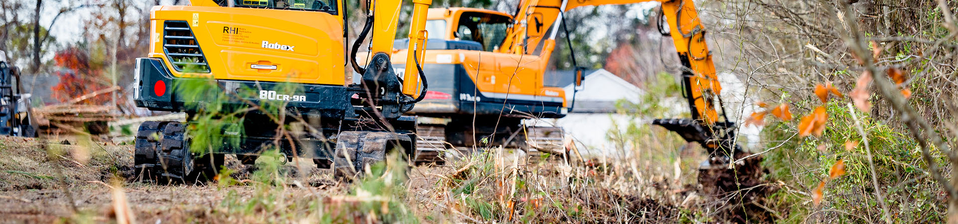 backhoe digging in ditch